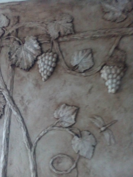 виноградная лоза на шпалере